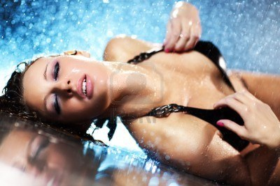6763213-young-woman-passion-water-studio-photo