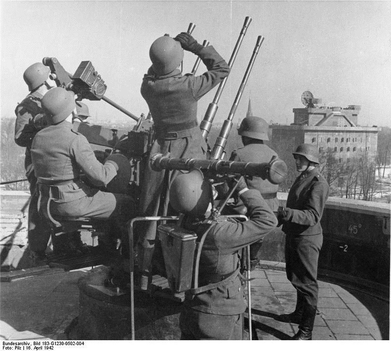 Soldiers with anti-aircraft guns and a distance measuring device at the Berlin Zoo flak tower, April 1942.